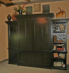 This murphy bed looks like an armoire but folds down to a full-size bed.  It also has a desk pull-out.